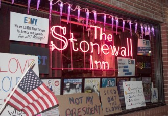 GREENWICH VILLAGE, NY 02/04/2017 STONEWALL INN/THE SOUL OF A PLACE: Outside sign of The Stonewall Inn on 53 Christopher Street in Greenwich Village with signs from the rally -Photo by Jessica Mahmoud